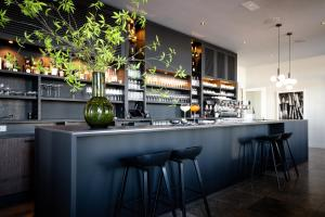 The lounge or bar area at Pillows Luxury Boutique Hotel Aan De IJssel