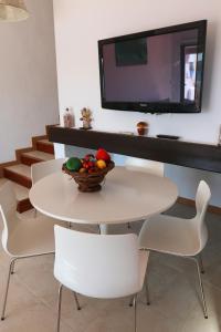 A television and/or entertainment center at Apartamentos El Bergantin Menorca Club