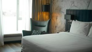 A bed or beds in a room at Radisson Blu Anchorage Hotel