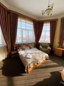 Кровать или кровати в номере Норд Стар Отель