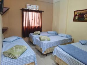 Cama ou camas em um quarto em Pousada Mãe Ternura palace