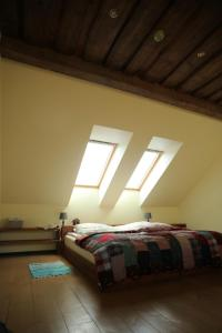 A bed or beds in a room at Ķērpji