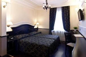 A bed or beds in a room at Hotel Best Roma