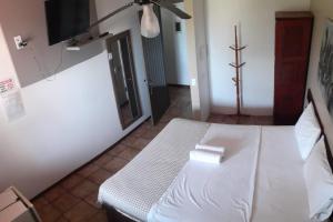 Cama ou camas em um quarto em Hotel Pousada Bossa Nova