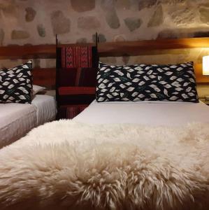 Una cama o camas en una habitación de Gaia