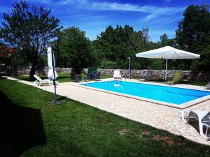 The swimming pool at or close to Agrotourism Galic Krka