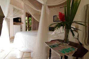 A bed or beds in a room at Pousada Magia Verde