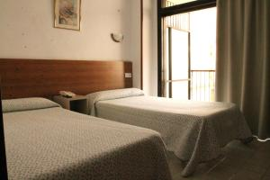 A bed or beds in a room at Pension Terminal