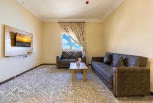 Uma área de estar em Lavent Park Hotel Suites
