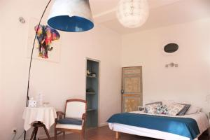 A bed or beds in a room at H2o Chambres d'Hôtes