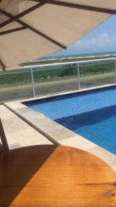 The swimming pool at or close to Pousada Canto do Mar Luís Correia