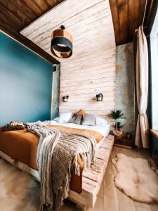 Łóżko lub łóżka w pokoju w obiekcie PORANEK W GÓRACH