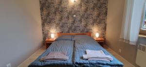 A bed or beds in a room at Karsibór DE