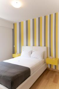 A bed or beds in a room at Varkiza Luxury Residence