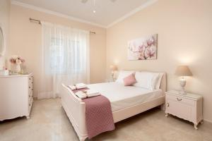 A bed or beds in a room at Armonia corfu apartment