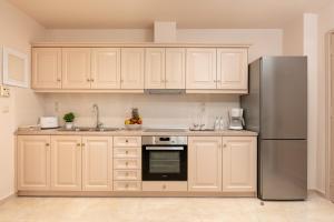 A kitchen or kitchenette at Armonia corfu apartment