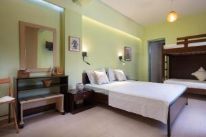 Ένα ή περισσότερα κρεβάτια σε δωμάτιο στο Niriides