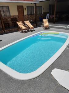 The swimming pool at or near Pousada Pelourinho