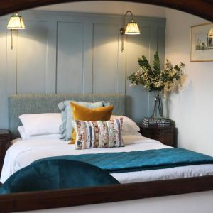 A bed or beds in a room at Tower Hotel