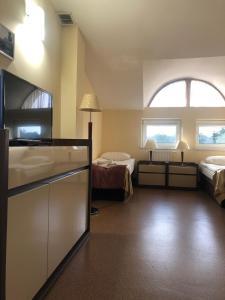 A bed or beds in a room at Villa Sulejówek