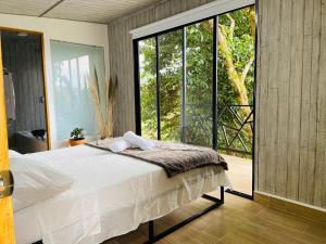 Cama o camas de una habitación en La Madriguera