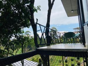 Un balcón o terraza de La Madriguera