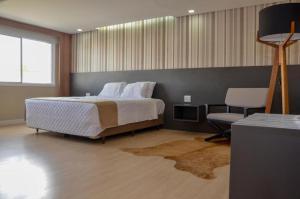 Cama ou camas em um quarto em M Tower Hotel