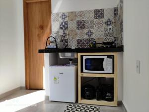 A kitchen or kitchenette at Flat Container Pontal do Atalaia