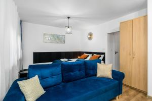 A seating area at Sleepway Apartments - Modern Dream