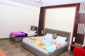 A bed or beds in a room at DUDI HOTEL