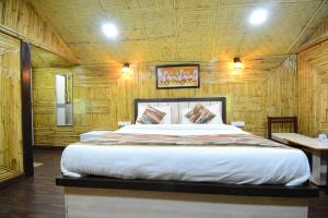 A bed or beds in a room at Hotel Bamboo Castle