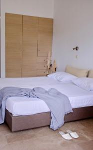 Letto o letti in una camera di Liostasi Retreat
