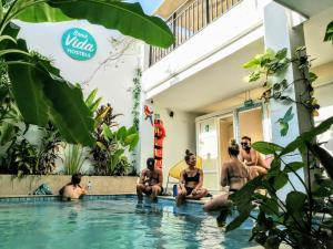 The swimming pool at or near Bona Vida Hostel La Quinta