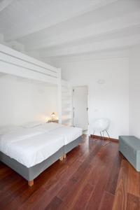 Uma cama ou camas num quarto em Aldeia da Pedralva - Slow Village