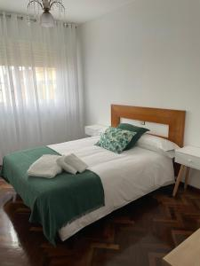 A bed or beds in a room at Piso O Percebe