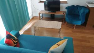 A television and/or entertainment center at FALCON PALAS SUİTEs