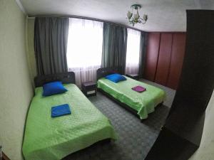 """Кровать или кровати в номере """"AMTO"""" Guest House"""
