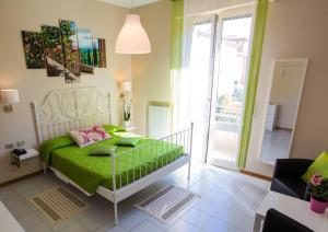 Ένα ή περισσότερα κρεβάτια σε δωμάτιο στο Hotel Arcoveggio