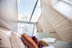 Ein Bett oder Betten in einem Zimmer der Unterkunft Glass Resort