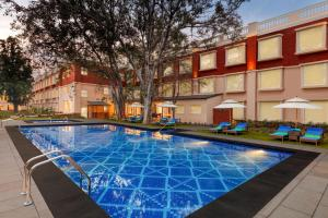 The swimming pool at or near Welcomhotel by ITC Hotels, Raja Sansi, Amritsar