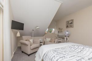 Een bed of bedden in een kamer bij Hotel-Restaurant van der Weijde