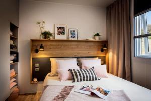 A bed or beds in a room at Camping Le Parc de Paris