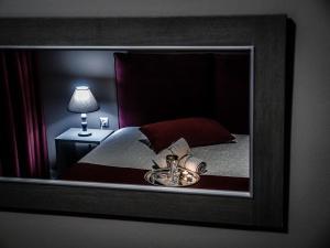 Ένα ή περισσότερα κρεβάτια σε δωμάτιο στο Gina's Studios