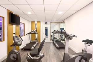 The fitness center and/or fitness facilities at Holiday Inn Lübeck, an IHG Hotel