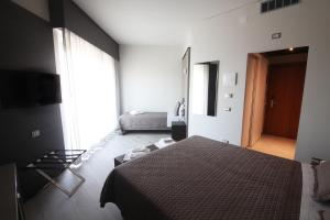 A bed or beds in a room at Hotel Santin