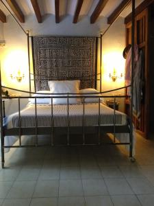 A bed or beds in a room at La Ventana