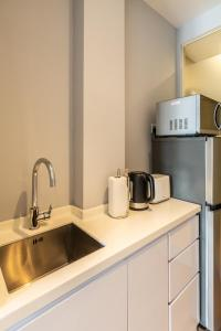 A kitchen or kitchenette at Heritage Collection on Clarke Quay (SG Clean)