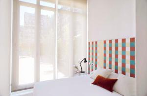 Un ou plusieurs lits dans un hébergement de l'établissement Eric Vökel Boutique Apartments - Gran Vía Suites