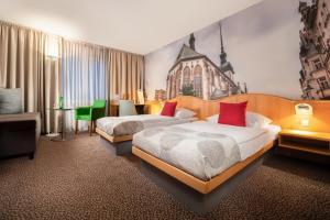 Postel nebo postele na pokoji v ubytování Cosmopolitan Bobycentrum - Czech Leading Hotels