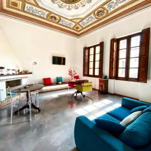Ein Sitzbereich in der Unterkunft Palazzo Bolasco